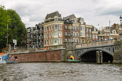 People on the beautiful old bridge in the historic part of Amste Stock Photos