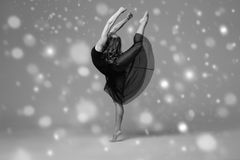 People Beautiful woman body on floor winter snow. Black and whit. E. Studio shot stock photography
