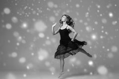 People Beautiful woman body on floor winter snow. Black and whit. E. Studio shot royalty free stock photography
