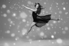 People Beautiful woman body on floor winter snow. Black and whit. E. Studio shot stock photos