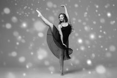 People Beautiful woman body on floor winter snow. Black and whit. E. Studio shot Royalty Free Stock Photo