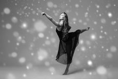 People Beautiful woman body on floor winter snow. Black and whit. E. Studio shot stock images