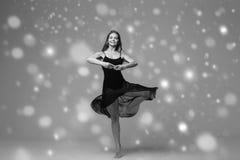 People Beautiful woman body on floor winter snow. Black and whit. E. Studio shot stock photo