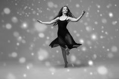 People Beautiful woman body on floor winter snow. Black and whit. E. Studio shot Stock Photo