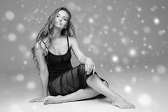 People Beautiful woman body on floor winter snow black and white. Studio shot royalty free stock images