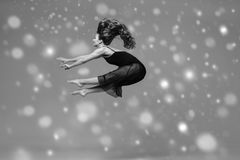 People Beautiful woman body on floor winter snow. Black and whit. E. Studio shot royalty free stock image