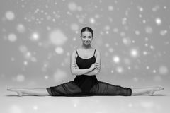 People Beautiful woman body on floor winter snow black and white. Studio shot Stock Images