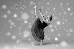 People Beautiful woman body on floor winter snow. Black and whit. E. Studio shot Royalty Free Stock Images