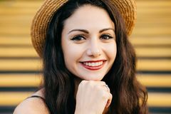 People, beauty, emotions concept. Close up portrait of beautiful brunette female with nice make-up and thin red lips smiling gentl stock photos