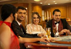 People behind gambling table Stock Image