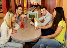 People behind table in bowling club Royalty Free Stock Photo