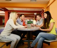 People behind table in bowling club Stock Photos