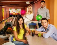 People behind table in bowling club Stock Photography
