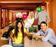 People behind table in bowling club Royalty Free Stock Images