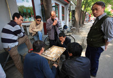 People in Beijing, China. People playing a board game in a street of Beijing. Beijing, also known as Peking, is the capital of the People's Republic of China. It royalty free stock images