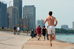 People Being Active Along Chicago Shoreline Stock Photo