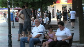 People on a bench in the center of Varna, Bulgaria stock footage