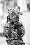People in Benin, in black and white. PORTO-NOVO, BENIN - MAR 8, 2012: Unidentified Beninese girl shuts her head. People of Benin suffer of poverty due to the stock image