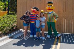 People with Bert and Ernie in Sesame Street area. at Seaworld in International Drive area . Orlando, Florida. April 20, 2019. People with Bert and Ernie in stock photo
