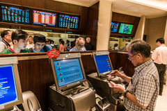 People betting horse races Happy Valley racecourse Hong Kong Stock Photos