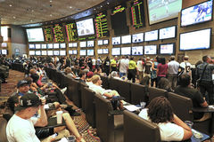 People betting. On their favorite and checking  the results Stock Photography