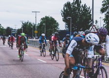 People on Bicycle Racing Under White Skies during Daytime Stock Photo