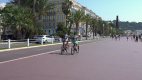 People on bicycles on Nice Promenade stock video