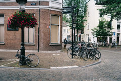 People and bicycles in street in historic centre of Utrecht, the Stock Photography