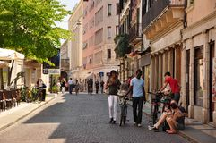 People with bicycles in the summer on the street royalty free stock photo