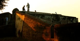 People on the big fort battlement and large wall at vellore fort with sunset Royalty Free Stock Image