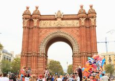 Masks supporting independence of Catalonia by Arc de Triomf in Barcelona. People in big tall masks of traditional Catalan figures supporting independence of Stock Image