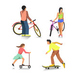 People on bike, boy on skateboard, girl on scooter Stock Image