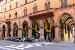 People and bike on the street Indipendenza in Bologna, Italy. Bologna, Italy - August 18, 2014: People and bike on the street Indipendenza in Bologna, Italy Stock Image