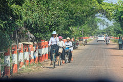 People on bikes, Cambodia Royalty Free Stock Images