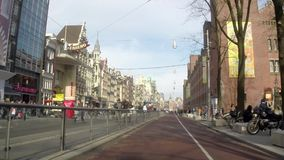 People, bikes and cars around the city center, Amsterdam stock video