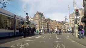 People, bikes and cars around the city center, Amsterdam stock video footage