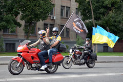 People on bikes with flags Royalty Free Stock Images