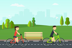 People on bikes ride in the city park. Stock Photography