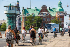 People biking in Copenhagen, Denmark. Copenhagen is one of the most bicycle friendly cities in the World.  Copenhagen, Denmark in a summer day Royalty Free Stock Photos