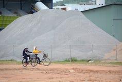 People biking on rural road in Phu Quoc, Vietnam Royalty Free Stock Photos
