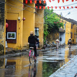 People biking on street in Hoi An, Vietnam Stock Images
