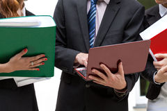 People with binders and netbooks. Office workers holding file binders and netbooks Royalty Free Stock Images