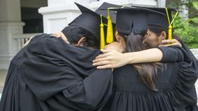 People with black gowns hug neck in grouping. The people with black gowns hug neck in grouping Stock Image