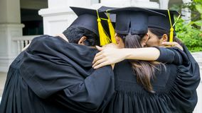 People with black gowns hug neck in grouping. The people with black gowns hug neck in grouping Royalty Free Stock Photo