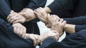 People with black gowns join hand in circle loop. The people with black gowns join hand in circle loop Royalty Free Stock Photo