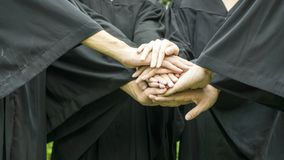 People with black gowns join hand in grouping. The people with black gowns join hand in grouping Royalty Free Stock Photo