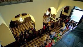 People in Black Madonna Chapel, Jasna Gora Monastery, Czestochowa, Poland. CZESTOCHOWA, POLAND - JUNE 12, 2018: The view from the upper balcony: people enter the stock video footage