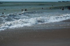 People in the black sea Stock Photo