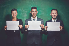 People with blank papers Stock Photography
