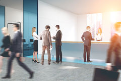 People in blue glass office Royalty Free Stock Photo